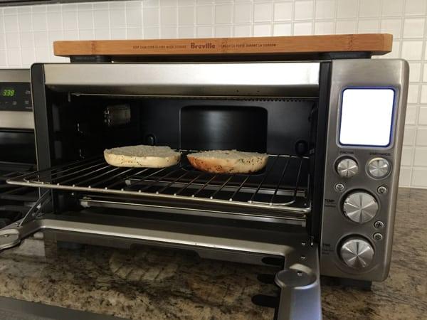 Two bagel slices inside a Breville Smart Oven Pro.