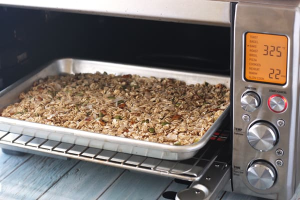 Granola cooking in a Breville toaster oven