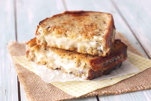 Gooey grilled cheese sandwich sliced open.