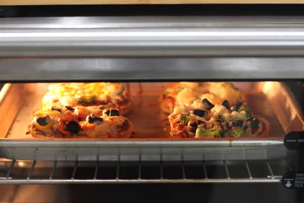 Pizza bagels baking in a Breville toaster oven